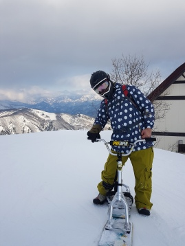 Fashionable Man with Snowbike